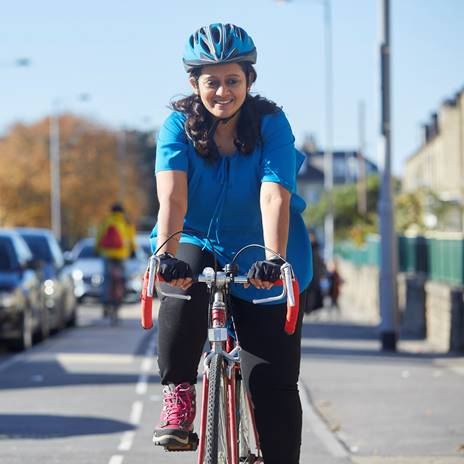 Woman cycling on segregated route