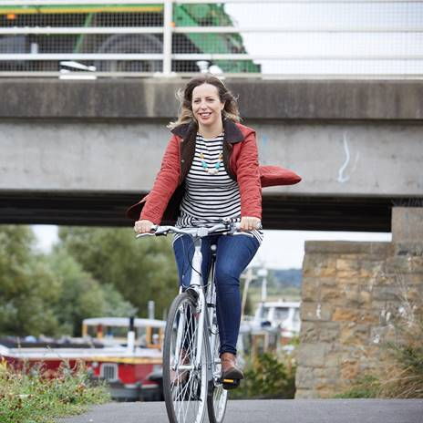 Woman cycling along greenway route