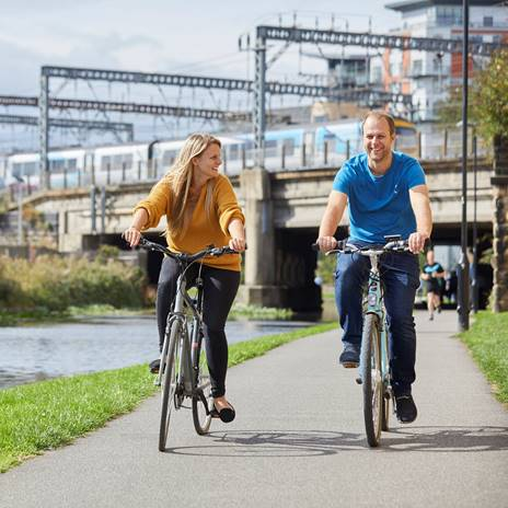 Woman and man on bikes on Leeds & Liverpool Canal