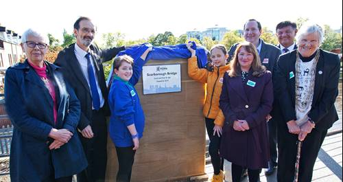 Katie Sherlock from Clifton Green Primary School and Ruby Lorains from St Barnabas CE Primary School unveiling a plaque on Scarborough Bridge with Cllr Kim Groves and Cllr Keith Aspden last autumn.