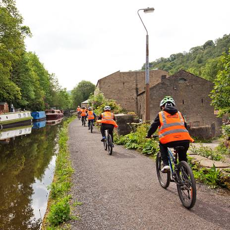 School kids cycling on the towpath