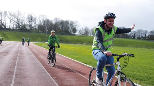 Man cycling on an athletics track at Thornes Park Stadium, Wakefield